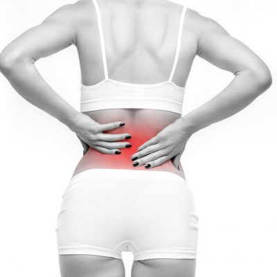 Back or lumbar pain, female person with backache